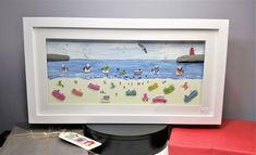 A summer holiday beach scene in Cornwall made from sea glass and sea shell beach combed finds