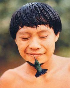 Indigenous and hummingbird kiss
