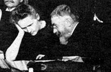 Marie Curie and Henri Poincaré talk at the 1911 Solvay Conference