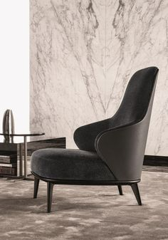 An inviting armchair declined in 7 versions. Minotti presents Leslie, a collection for cozy and intimate spaces