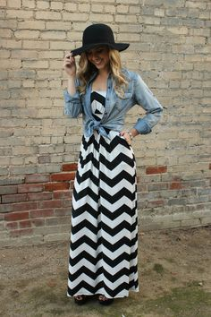 Be bold in this black and white zig-zag print maxi dress. Strapless with an elastic waistline and POCKETS! Yes, this awesome dress has pockets. - No bust padd