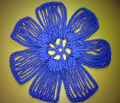This crochet flower is really unique and fun for yarn lovers to try. The technique of combining crochet fork with hook is great to make bigger flower patte
