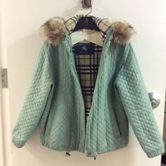 Burberry light teal quilted jacket with hood Beautiful well-loved jacket. Fur trim is raccoon and removable. NOTE: pen stains and discoloration by the pockets, loose threads on quilting. Burberry Jackets & Coats