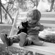 Toddler feeding a kitten...the cuteness is unbearable