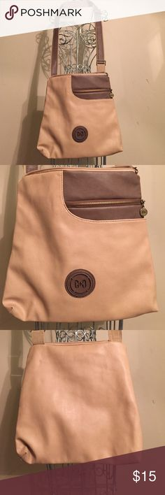 Coco + Carmen crossbody bag NWOT tan NWOT coco + Carmen tan and brown crossbody handbag.  Never used but has two very small knicks one on the back and one on side. Seen in pic! Multiple compartments with adjustable strap. Height 13 1/2' width at bottom 13 1/2 width at the top 11 1/2 Coco+carmen Bags Crossbody Bags