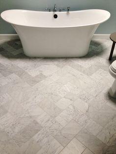 6x12 Venetino marble tiles set in the herringbone pattern on this Master Bathroom floor.