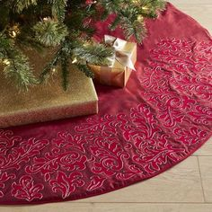 Wrap your tree in love with our beautifully embroidered tree skirt that creates the perfect backdrop for all your expertly wrapped gifts. The classic red hue is a holiday favorite and easily incorporates into any decor style.