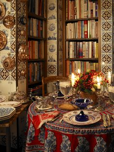 Dining table, cookbooks, Delft tiles, copper - Howard Slatkin's wonderful kitchen (Fifth Avenue Style)