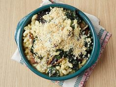 Creamy Baked Macaroni and Cheese with Kale and Mushrooms : Don't be alarmed by how much kale you start with for this recipe. It will cook down quite a bit and pairs deliciously with the creamy pasta and shiitake mushrooms.