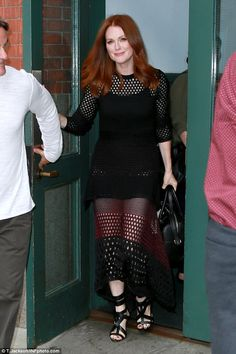 Spot on! Julianne Moore stepped out her hotel in New York City, looking absolutely incredible in aperforated black dress