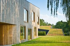 Image 3 of 23 from gallery of Houses In Rybnik / Jojko+Nawrocki Architekci. Photograph by Juliusz Sokołowski Architecture Plan, Residential Architecture, Green Roof Benefits, Houses In Poland, Wooden Facade, Living Roofs, Underground Homes, Small Buildings, House Roof