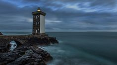 The lighthouse of Kermorvan is located Northwest of the village of Le Conquet in the Finistère district in Brittany (Bretagne) in France. It was built in 1849 on a rock at the point of Kermorvan peninsula and is the most western French lighthouse on the main land. This long exposure photo was taken during a cloudy evering after sunset.