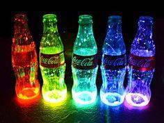 put those little glow-stick bracelets into glass coke bottles. hanging coke bottles with flowers that glow when it gets dark