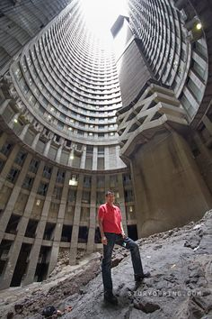 Ponte City is a skyscraper in the Hillbrow neighbourhood of Johannesburg, South Africa. built in The building is cylindrical, with an open center allowing additional light into the apartments. End Of Apartheid, Sa Tourism, Tower Block, Thing 1, Interesting Buildings, Slums, African History, Abandoned Buildings, Urban Planning