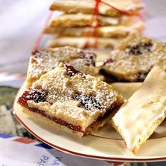 For years, travelers returned from Linz, Austria, singing the praises of linzertorte, made with a buttery-nut crust and filled with raspberry jam. This recipe is a bar-cookie adaptation of the popular torte.