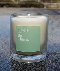By Laura Signature Candles. Available in 4 main scents:  - Lavender & Orange Blossom - Green Tea & Mint  - Reset  - Vanilla & Peppermint  - Rosemary
