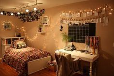 Cool college dorm lighting using Christmas string lights attached to photos.