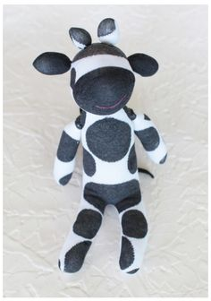 Milky The Cow Sock Animal 22.99 at shopruche.com. This soft, cotton-blend, black and white sock cow will bring joy to your little one with his snuggly texture, cute smile, and floppy ears and tail.Outer: 35% Cotton, 65% Terylene, Inner Fill: 100% Terylene, Imported, Approx. 16