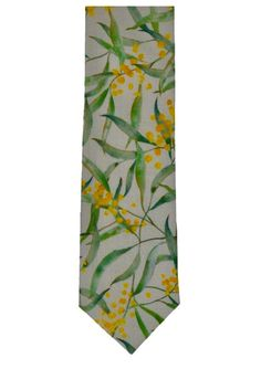 The Australian floral emblem adorns this cotton tie by Torquay design team Peggy and Finn. A bright and cheerful tie to compliment the warmer weather, the tie features the much loved golden wattle flowers on a white background accentuated wit. Australian Gifts, Australian Flowers, Christmas Gift Guide, Christmas Shopping, Grey Tie, Modern Gentleman, Wedding Ties, Flowering Trees, Yellow Flowers