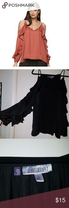 Jennifer Lopez black cold shoulder top This black flowing cold shoulder top is perfect for spring and summer. Never worn brand new sadly I bought a large and needed a medium. Can ship next day Jennifer Lopez Tops Blouses