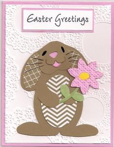 handmade Easter card: Greetings by bmbfield ... adorable bunny ... paper pieced ... luv how she used printed papers in the same kraft color to make inside of ears and belly ... delightful card!! ... Hero Arts