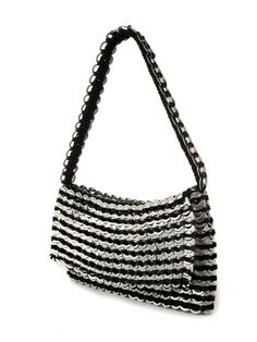 Francisca Evening Bag •Clutch Shoulder bag with fold over flap •Made from over 500 post-consumer recycled aluminum pop tops •Handcrafted with unique crochet technique •Soft crochet underside onshoulder strap •Fully lined with silver brocade fabric •Lightweight and supple aluminum shell •Produced following fair trade principles Artisan Country: Brazil $92.00 USD #shoppingforachange…