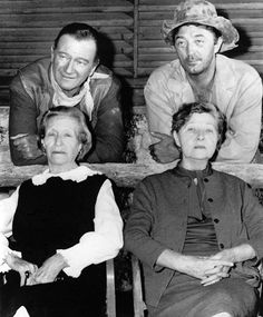 John Wayne and Robert Mitchum with their respective mothers, Molly and Ann, on location in Tucson, Arizona for El Dorado, 1965.