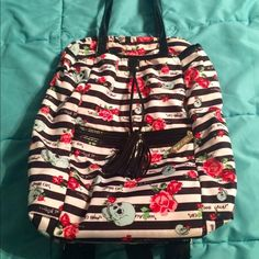 Betsey Johnson backpack! Only used a handful of times, and in great condition. It's great to use for school since it's large enough to carry a laptop and some notebooks if you'd like. It's also great for travel, or used as a handbag (handles located on top). I normally wouldn't be selling this, but I need the money! Price negotiable! Betsey Johnson Bags Backpacks