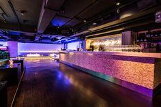 7 Heaven night club in Lan Kwai Fong, Hong Kong designed by Liquid Interiors. night club design, nightlife design, bar design, wall tile design, colorful lighting, simple and modern