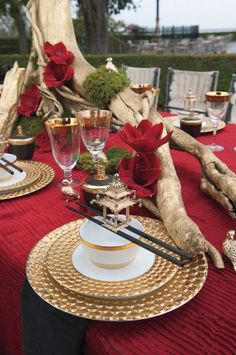 Asian inspired couture tabletop pays homage to venerable traditions of ancient art and craft with Chinese-style using ruby amaryllis and 24K gold details and décor.