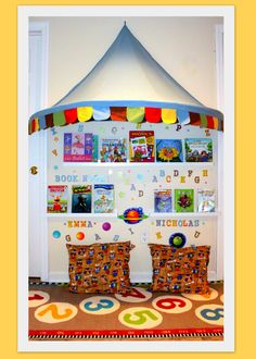 Kid's book nook ~ Little book area I made in a section of our playroom! The shelves are photo ledges from Ikea, as is the rug. The tent is also from Ikea and sooo easy to assemble. Insert the plastic pole and it just hangs by one nail from the top! Pillows were made by cutting a king size pillow in half (cheaper than buying pillow forms!) and I sewed the covers with fabric from the Joann's back to school collection. Stickers are from Dollar Tree!