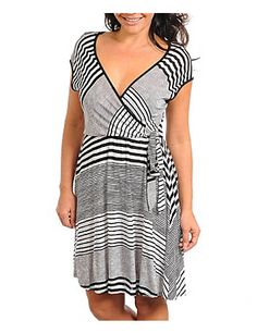 Black and white striped dress has a wrap style bodice that ties at the side, a flattering v-neckline, and an elastic waist. Unlined. sonsi.com