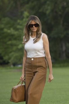 These pants are a bit too boxy for you.  You have such elegant Goddess Curves that wearing a cut that is too straight defeats your general shape.  I'd like to see more of a flow going on - like Palazzo Pants that have some flow and movement.  You are so graceful, why not be the Goddess that YOU ARE!
