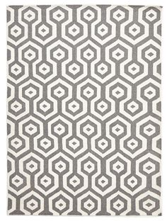Loviisa is a Nordic style kilim rug. Featuring a grey honeycomb pattern, this flatweave rug is reversible and was hand-knotted in India with 100% pure wool. While inspired by a contemporary Scandinavian look, this range has been constructed using ancient looming techniques.