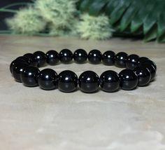 Unisex 8mm Black Tourmaline Bracelet, Protection Bracelet, Tourmaline Bracelet, Gift For Her, Gift For Him, Selenite Crystal For Charging by SymbolicGems on Etsy https://www.etsy.com/listing/522589341/unisex-8mm-black-tourmaline-bracelet