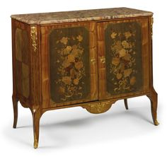 A Louis XV/XVI Transitional style ormolu-mounted tulipwood, marquetry and parquetry meuble d'appui. Sotheby's
