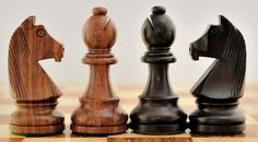 Stained Dyed / Shesham Wood Staunton Tournament Chess Set with German Knight. http://www.chessbazaar.com/chess-pieces/wooden-chess-pieces/stained-dyed-shesham-wood-staunton-tournament-chess-set-with-german-knight.html