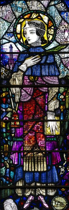https://flic.kr/p/C9ts8g | STURMINSTER NEWTON, St Mary. Harry Clarke. | Harry Clarke's lovely Art-Deco style window at Sturminster Newton, 1921. In memory of the young Roma Spencer-Smith who died in the great flu epidemic. Centre light is the Virgin Mary and Christ-child, possibly based on her young son. Left light is St Elizabeth of Hungary, the patron saint of nursing - Roma was a nurse in the Great War - and it is in Roma's likeness, hence the red hair. The right light is St Bar...