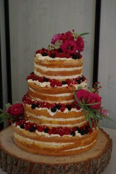 Naked cake with fresh fruits and flowers