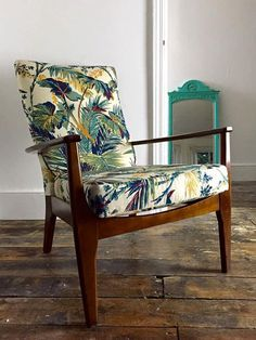 This mid century Parker Knoll chair delivers complete comfort and style. it has been newly reupholstered in a rare vintage palm fabric brought from Spitalfield Vintage Market, London. This chair would make for a great statement piece in any home. Upcycled Furniture, Chair Upholstery, Knoll Chairs, Upholstered Furniture, Furniture Upholstery, Chair, Chair Fabric, Mid Century Style Dining Chairs, Upholstered Chairs