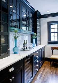 Cabinets help create a bold focal point in the room