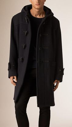 Burberry long duffle coat in a warm wool and mohair. The hooded design features a traditional toggle closure, oversize patch pockets and button-tab cuffs. Discover the men's outerwear collection at Burberry.com