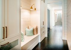 This mudroom is not big but built-in cabinets flanking a storage bench certainly adds to this space. Don't you love the lighting and the shiplap walls? Dreamy!
