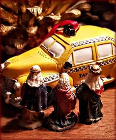 After bickering about Uber v. Lyft, the Magi finally agree to go and go home with a classic Yellow Cab. (Schlep of the Magi 2015)