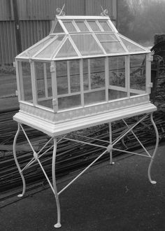 A Wardian case. Made using old glass, on an iron stand, and with a zinc-lined water proof base. Each end opens in a pair of doors for access and ventilation.   Period detailing throughout, with absolutely no visible welding. Iron and lead decoration. We have made several of these, in different sizes, and all with unique detailing.