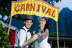 WAHH their site got hacked, but this was the coolest carnival/circus themed wedding... they said the site will be up soon, so hopefully they'll hurry it up and we can check out the pix from this amazing wedding!