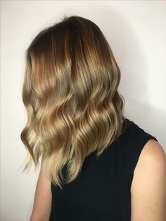 Natural golden blonde balayage and beach waves by Erin Macdonald, Chicago IL