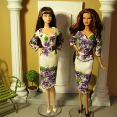 Two Barbie doll dresses made from the same vintage hankie