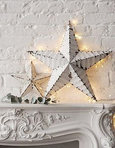 White tin stars with lights behind.