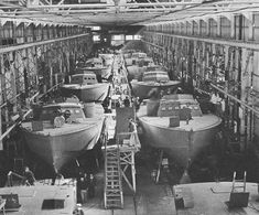 NH Higgins Type PT Boats on the assembly line at Higgins Industries City Park Plant, New Orleans, Louisiana, during World War II. The boats completion state advanced from the rear of the photograph toward the front. Naval History, Military History, Mtb, Brown Water Navy, E Boat, Landing Craft, Us Navy Ships, Ww2 Pictures, United States Navy